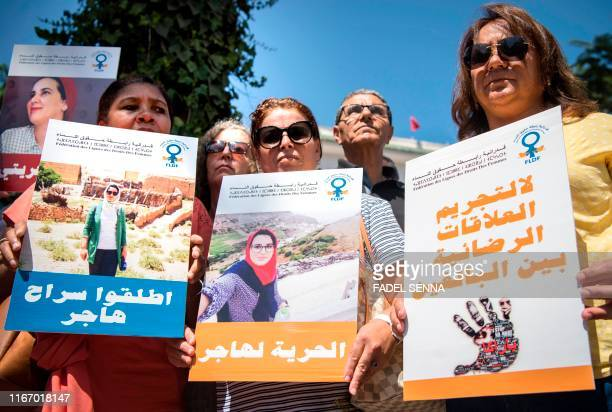 Demonstrators hold up signs showing the portraits of Hajar Raissouni a Morrocan journalist of the daily newspaper Akhbar ElYoum with captions reading...