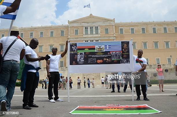 Demonstrators holding a banner in front of the Greek parliament A rally in the center of Athens organized from Biafrans that live in Greece to...