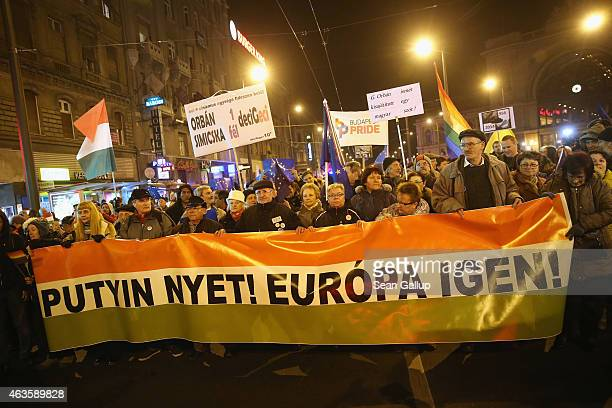 Demonstrators holding a banner that reads 'Putin No Europe Yes' march to protest against tomorrow's scheduled visit to Budapest by Russian President...