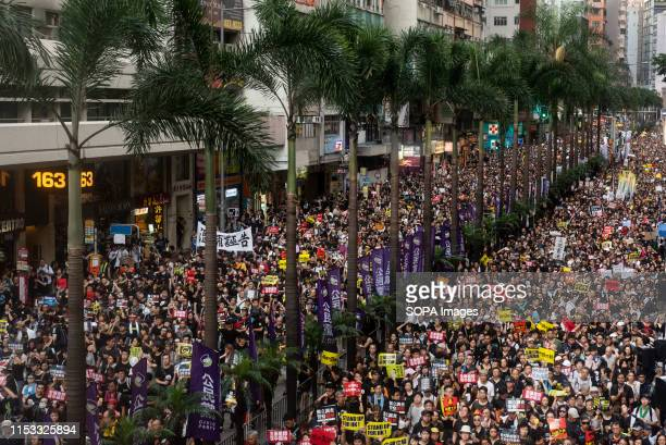 Demonstrators holding anti government placards and chanting slogans during the March Thousands of antigovernment demonstrators took to the street to...