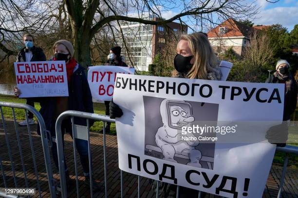 Demonstrators holding banners in front of the Russian embassy in the Netherlands in support of Russian dissident Alexei Navalny and against President...