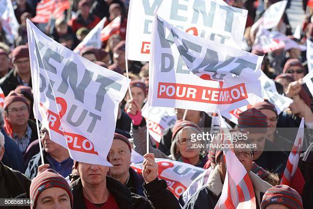 Demonstrators holding banners reading 'Headwind for employment' gather on January 24 in Brest northwestern France during a demonstration to maintain...