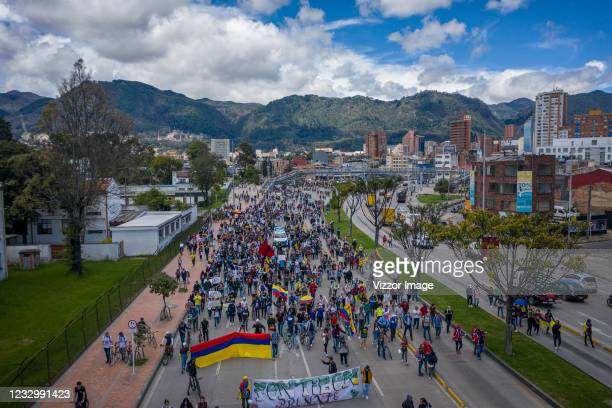 Demonstrators holding Colombian flags gather in front of National University during a protest as part of a national strike on May 19, 2021 in Bogota,...