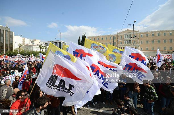 Demonstrators holding flags of the PAME union stand in front of the Greek Parliament in Syntagma Square Greek PAME union organised a demonstration in...