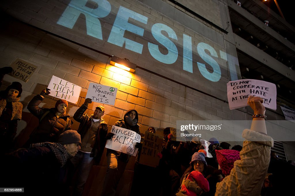 Demonstrators Protest At JFK Airport As White House Defends Immigrant Ban : News Photo