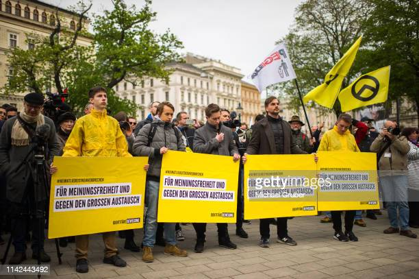 Demonstrators holding signs during an Identitarian protest in front of the Justice Ministry on April 13, 2019 in Vienna, Austria. Austrian law...
