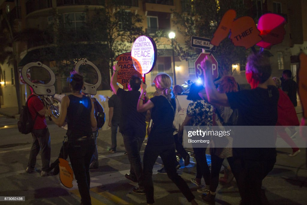 Demonstrators attend one year anniversary of first anti trump