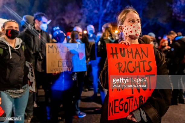 Demonstrators holds a banner as she takes part in a pro-choice protest in central Warsaw, on November 18 as part of a wave of protests nationwide...