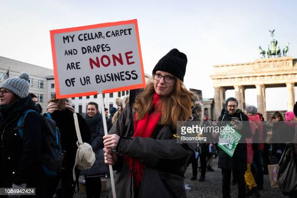 A demonstrators holds a banner reading 'My Cellar carpet and drapes are none of ur business' during the Berlin chapter of the Women's March Global...