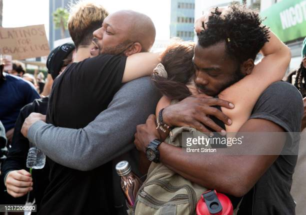 Demonstrators hug during a march in response to George Floyd's death on June 2 2020 in Los Angeles California Floyd died while in Minneapolis police...