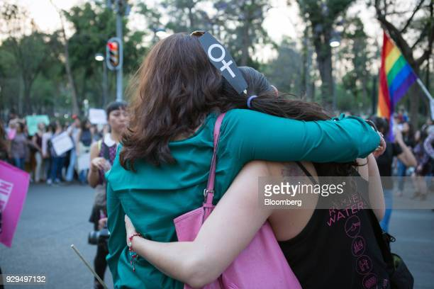Demonstrators hug during a national strike on International Women's Day in Mexico City Mexico on Thursday March 8 2018 The United Nations first...