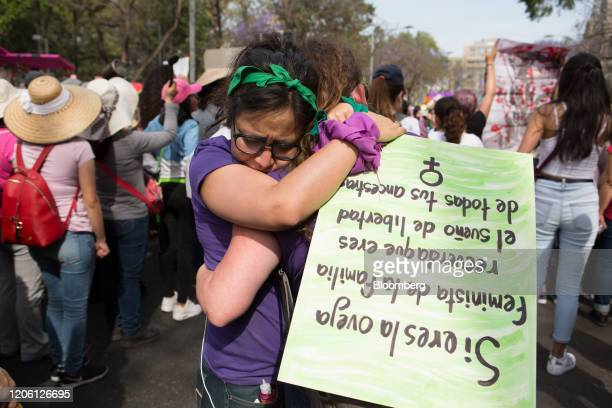 Demonstrators hug each other during a rally on International Women's Day in Mexico City Mexico on Friday March 8 2020 The United Nations first...