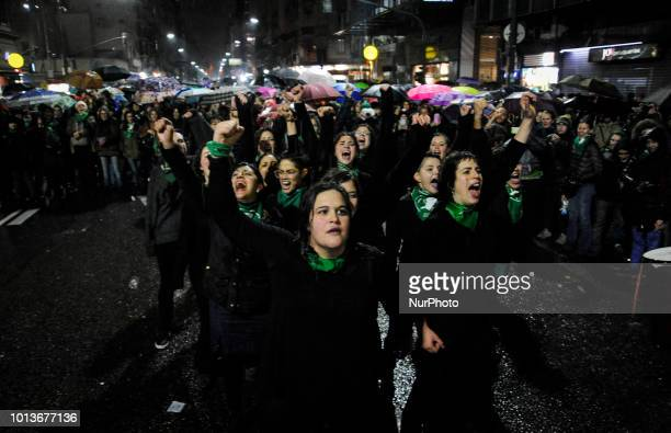 Demonstrators in support of decriminalizing abortion stands outside Congress in Buenos Aires Argentina Wednesday Aug 8 2018
