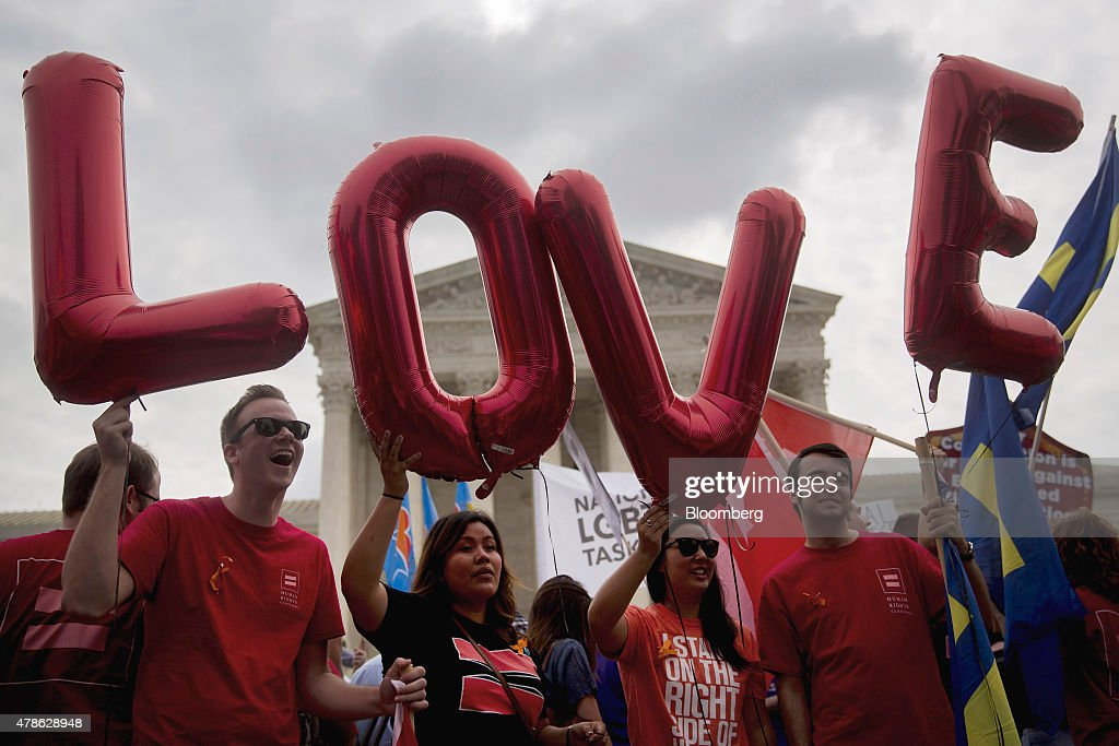 Demonstrators in support of same-sex marriage spell out 'LOVE' with balloons before the same-sex marriage ruling outside the U.S. Supreme Court in Washington, D.C., U.S., on Friday, June 26, 2015. Same-sex couples have a constitutional right to marry nationwide, the U.S. Supreme Court said in a historic ruling that caps the biggest civil rights transformation in a half-century. Photographer: Andrew Harrer/Bloomberg via Getty Images