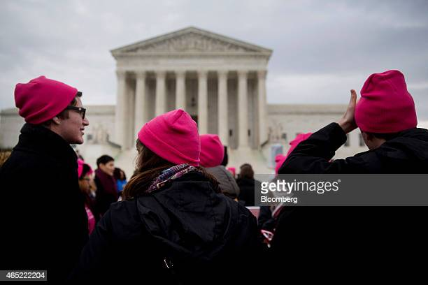 Demonstrators in support of US President Barack Obama's healthcare law Obamacare wear pink hats to support Planned Parenthood in front of the US...