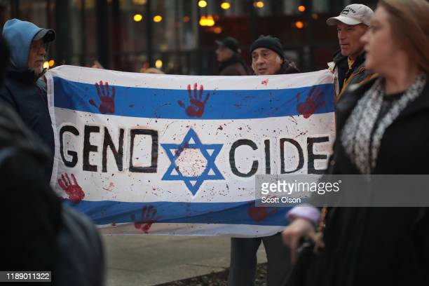 Demonstrators in the Federal Building Plaza protest the deaths of more than 30 Palestinians who were killed last week from Israeli air strikes in...