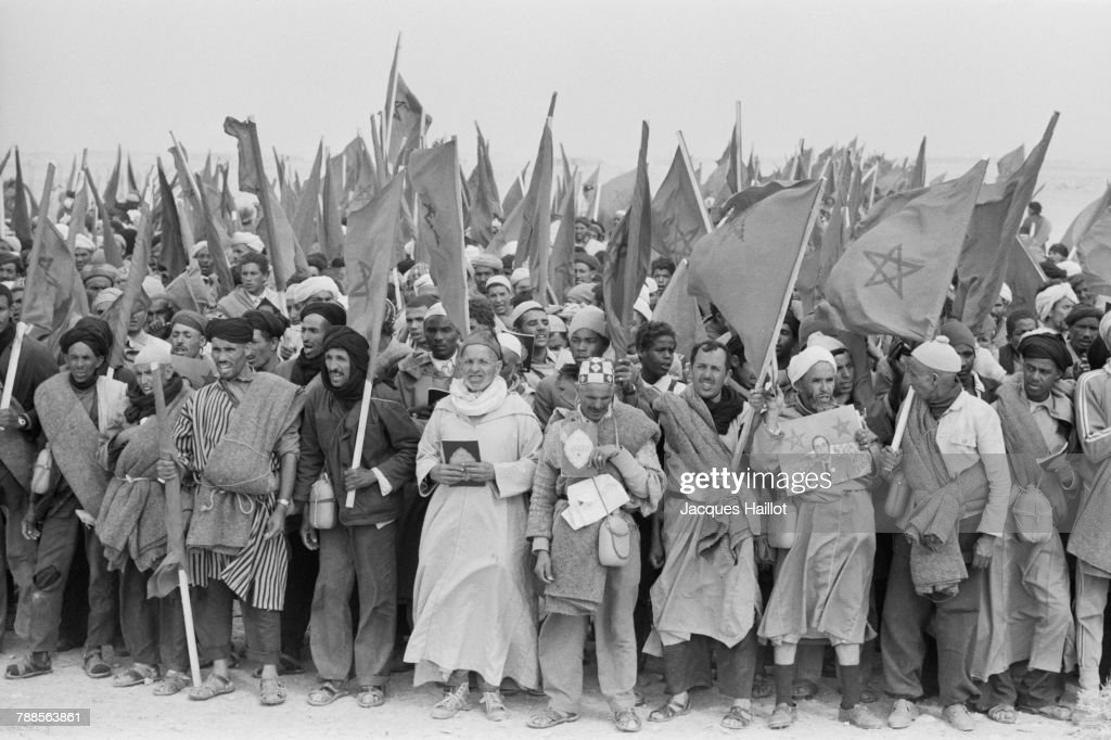 Demonstrators in the Green March step forward to West Sahara. Around 350,000 unarmed Moroccans peacefully occupied the Spanish Sahara.