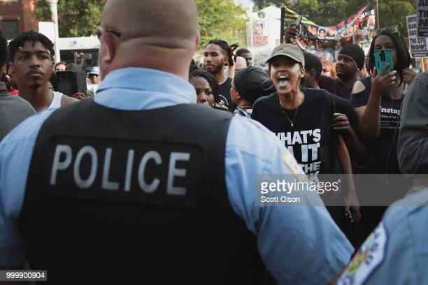 Demonstrators in the South Shore neighborhood protesting the shooting death of 37yearold Harith Augustus have a heated exchange with police on July...