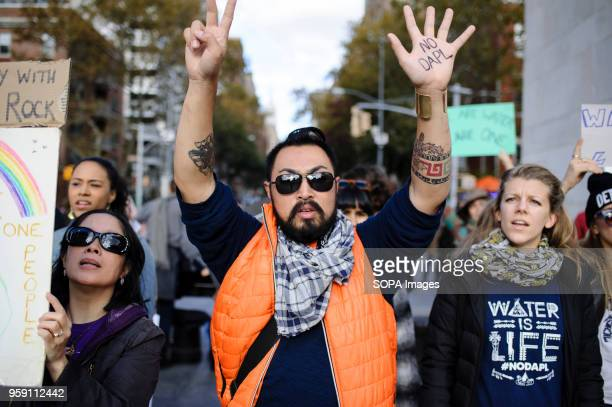 Demonstrators in Washington Square Park stage a protest against the controversial planned development of the 1200mile Dakota Access Pipeline through...