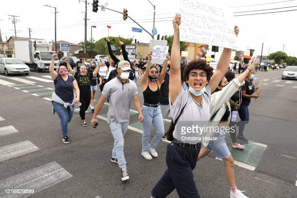 Demonstrators including Dillon Redd front march in the streets in a peaceful protest in Cerritos on Monday June 1 2020
