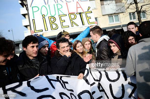 Demonstrators including French urgentist and contributor to French satirical magazine Charlie Hebdo, Patrick Pelloux pose on January 23, 2015 outside...