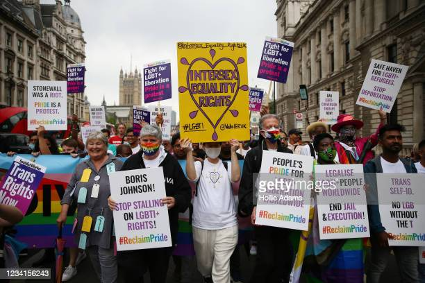 Demonstrators including Linda Riley, from Diva Magazine, activist Peter Tatchell and founder of UK Black Pride Lady Phyll hold placards during the...