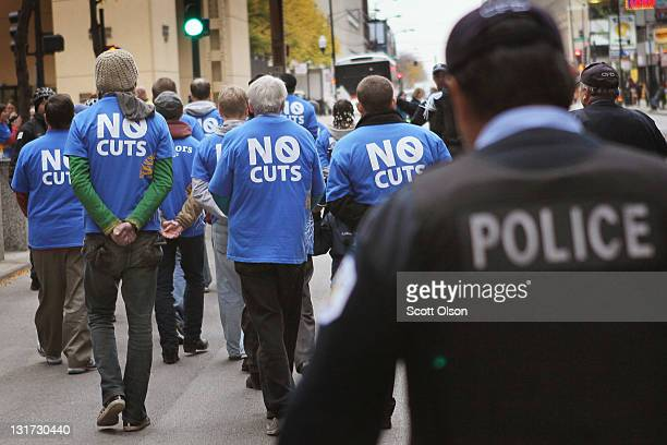 Demonstrators including many senior citizens are led away by police during a protest against cuts to federal safety net programs including Social...