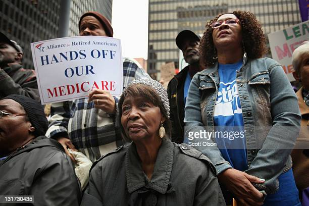 Demonstrators including many senior citizens protest against cuts to federal safety net programs including Social Security Medicare and Medicaid on...