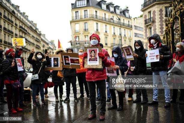 Demonstrators including Myanmar nationals, hold portraits and placards during a protest against the military coup and to demand the release of...
