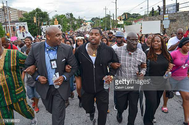 Demonstrators including rapper Lil Scrappy march from Sankofa Church of Christ to the CNN Center in protest of the acquittal of George Zimmerman who...