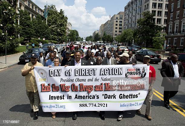 Demonstrators including Reverend Jesse Jackson rally in protest calling on US President Barack Obama to end the socalled War on Drugs which they say...