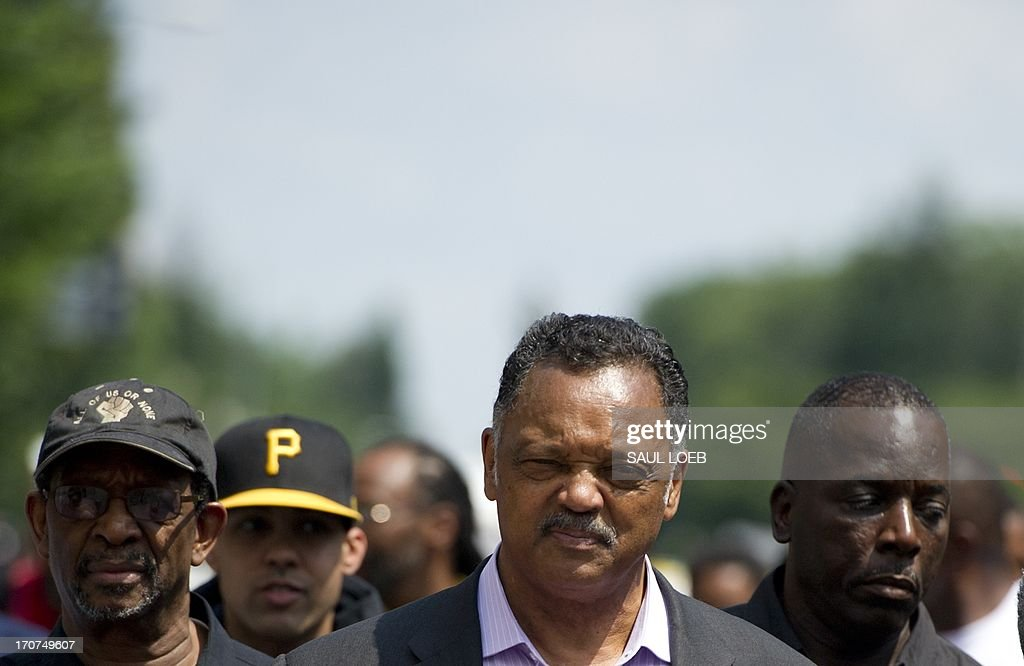 Demonstrators, including Reverend Jesse Jackson (2nd R), rally in protest calling on US President Barack Obama to end the so-called 'War on Drugs,' which they say leads to mass incarceration of African Americans, as well as wanting additional investment in jobs and economic development in urban inner-city neighborhoods, during a 'Day of Direct Action' march through the streets of Washington on June 17, 2013, enroute to Lafayette Park adjacent to the White House. AFP PHOTO / Saul LOEB