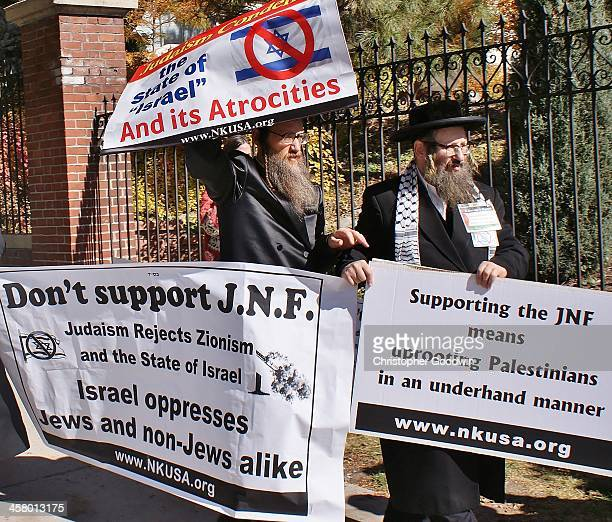 CONTENT] Demonstrators including these members of the orthodox Jewish group Neturei Karta gathered outside the Governor's Mansion in Denver to...