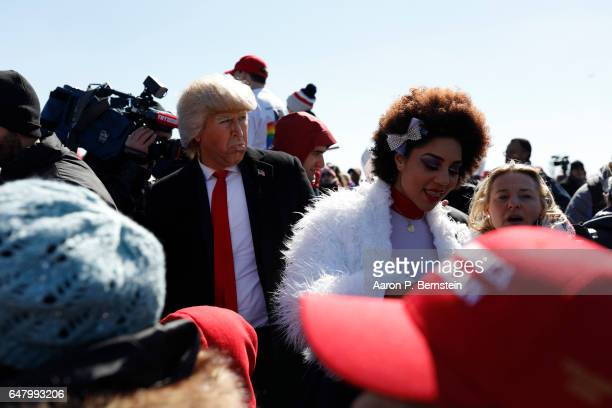 Demonstrators including Trump impersonator Dustin Gold and singer Joy Villa gather near the Washington Monument during the March4Trump on March 4...