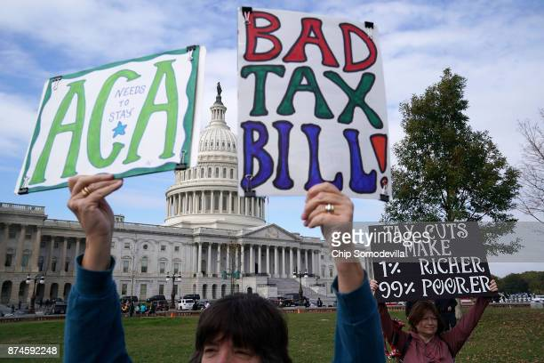 Demonstrators join a rally against the proposed Republican tax reform legislation on the east side of the US Capitol November 15 2017 in Washington...