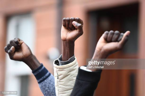 Demonstrators join a 'Refugees Lives Matter' protest on July 1 2020 in Glasgow Scotland The antiracism demonstration called for an end to the...