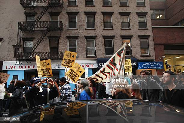 Demonstrators joined by members of the Occupied Wall Street Movement march near Baruch College in Manhattan to protest against proposed tuition...