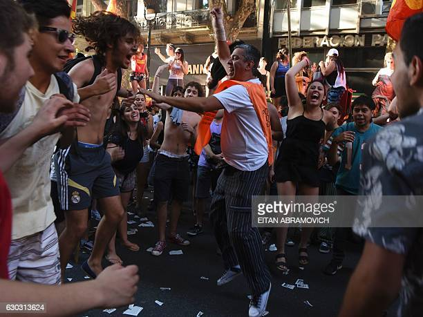 Demonstrators jump and chant slogans during a march for the 15th anniversary of former President Fernando de la Rua ousting in Buenos Aires on...