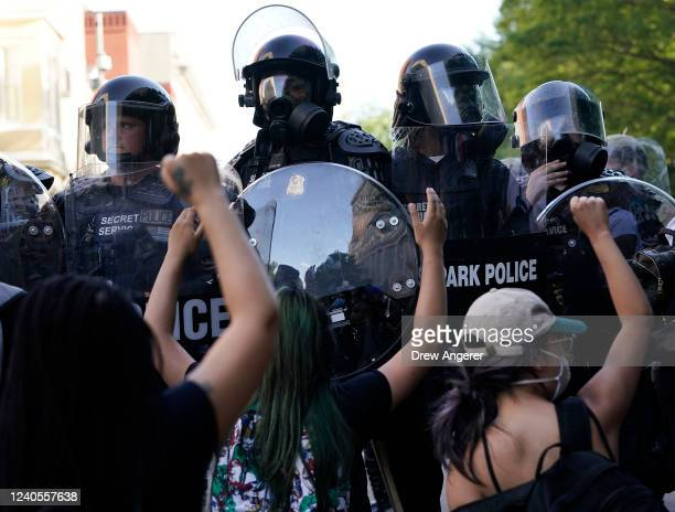 Demonstrators kneel in front of law enforcement during a protest on June 1 2020 in downtown Washington DC Protests and riots continue in cities...