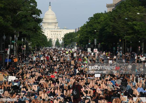 Demonstrators lay down on Pennsylvania Avenue during a peaceful protest against police brutality and the death of George Floyd on June 3 2020 in...