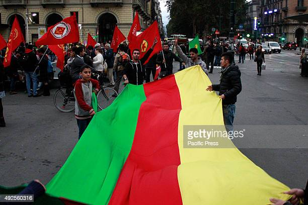 Demonstrators lay flags during a protest against the Turkish President Erdogan and the attack in Turkey with 87 dead and over 200 injured on October...