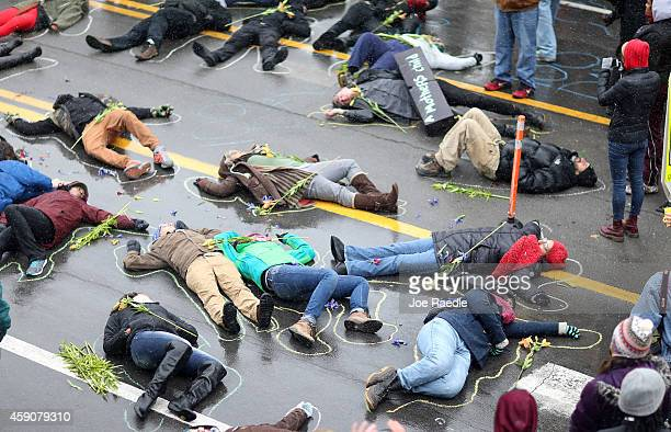 Demonstrators lay on the ground in a mock death protest of the shooting death of Michael Brown by a Ferguson police officer on November 16, 2014 in...