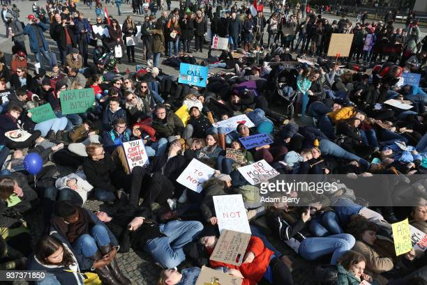 Demonstrators lay on the ground in protest at the March for our Lives demonstration on March 24 2018 in Berlin Germany The protest in Berlin was...