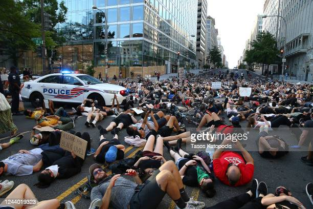 Demonstrators lay on the street near Freedom Plaza during a protest against police brutality and the death of George Floyd on June 3 2020 in...