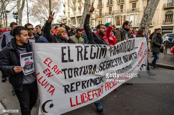 Demonstrators leading the march carrying a large banner Third March in Barcelona by the resistance freedom and justice of the people of the Rif...