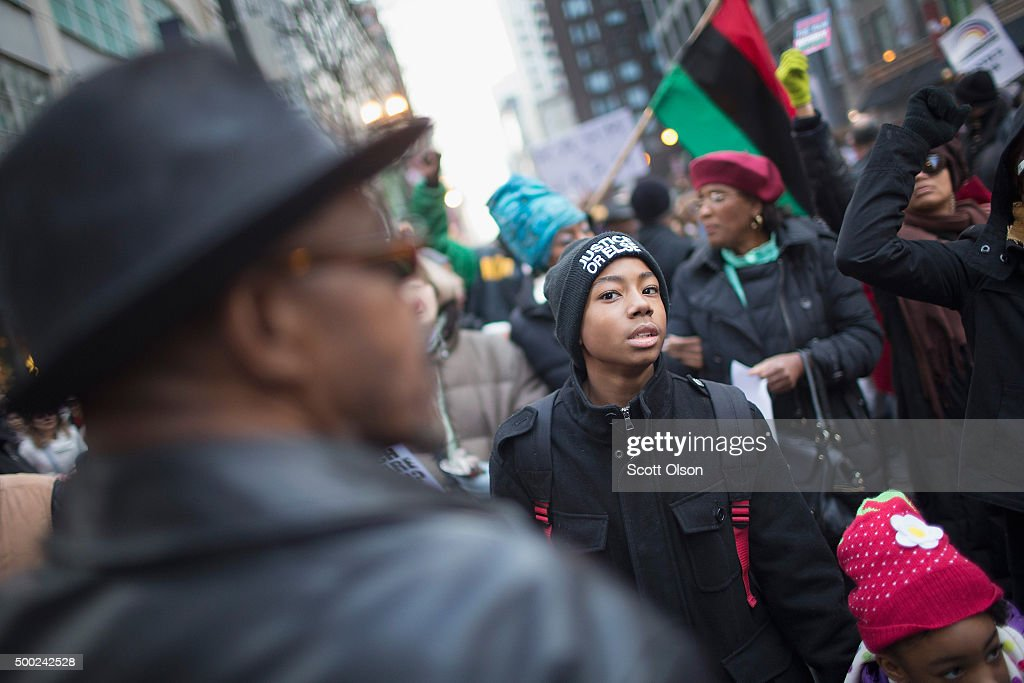 Demonstrators led by Rev. Jesse Jackson march down State Street to protest the death of Laquan McDonald and the alleged cover-up that followed on December 6, 2015 in Chicago, Illinois. Chicago Police officer Jason Van Dyke shot and killed 17-year-old McDonald on October 20, 2014, hitting him with 16 bullets. Van Dyke was charged with murder more than a year after the shooting after a judge ordered the release to the public of a video which showed McDonald backing away from Van Dyke while being shot.
