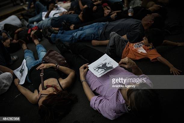 Demonstrators lie down on the floor during a protest to demand the clarification of the murder of photojournalist Ruben Espinosa who was killed in...