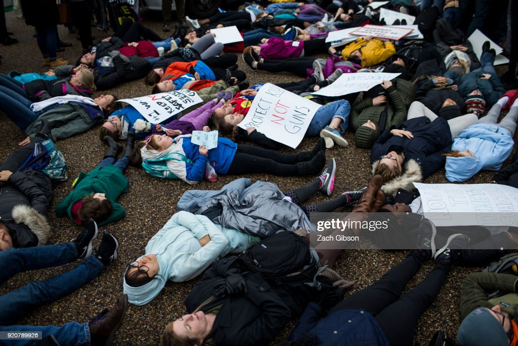 Demonstrators lie on the ground a 'lie-in' demonstration supporting gun control reform near the White House on February 19, 2018 in Washington, DC. According to a statement from the White House, 'the President is supportive of efforts to improve the Federal background check system.', in the wake of last weeks shooting at a high school in Parkland, Florida.