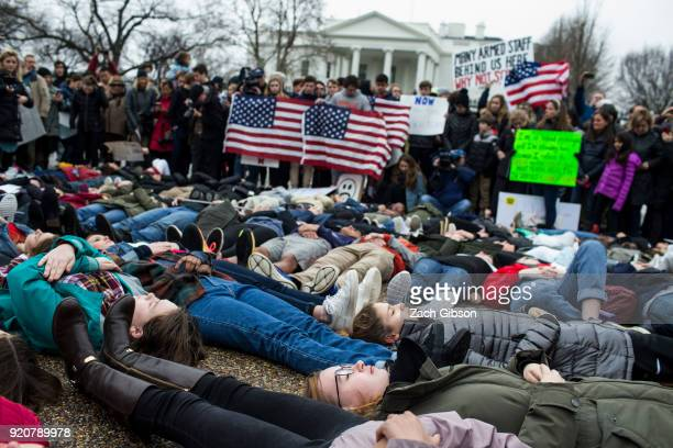Demonstrators lie on the ground a liein demonstration supporting gun control reform near the White House on February 19 2018 in Washington DC...