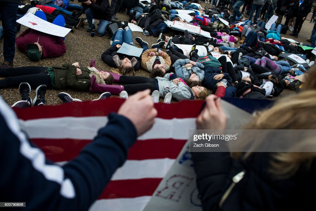 Demonstrators lie on the ground during a 'lie-in' demonstration supporting gun control reform near the White House on February 19, 2018 in Washington, DC. According to a statement from the White House, 'the President is supportive of efforts to improve the Federal background check system.', in the wake of last weeks shooting at a high school in Parkland, Florida.